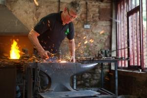 "Andy hard at work "" Bashing Metal at Powderham"""